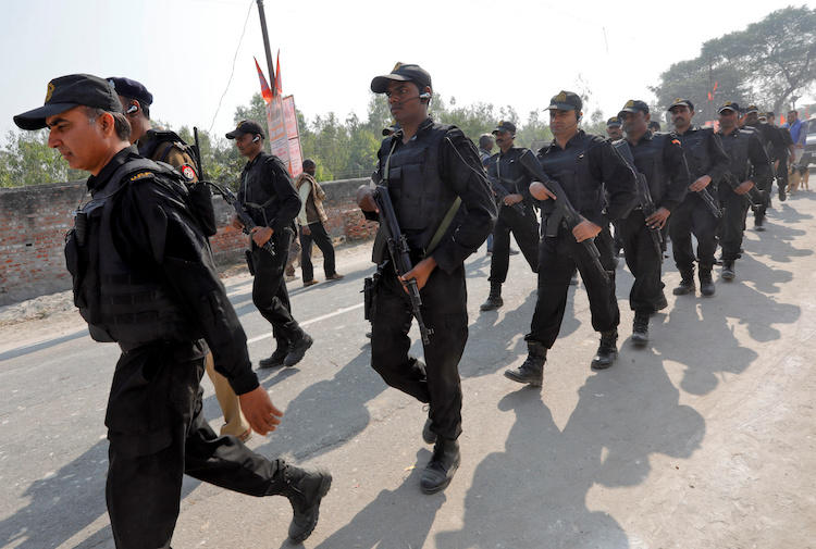 Police officers are seen in Uttar Pradesh, India, on November 25, 2018. Uttar Pradesh police recently arrested two TV journalists in a defamation case in the state. (Reuters/Pawan Kumar)