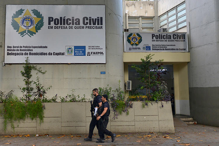 Police officers walk in front of the homicide department in Rio de Janeiro, Brazil, on March 13, 2019. Journalist Romário Barros was recently killed in Maricá, in Rio de Janeiro state. (Reuters/Lucas Landau)