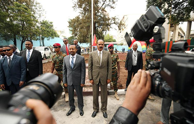 Eritrean President Isaias Afwerki, right, stands with and Ethiopian Prime Minister Abiy Ahmed in Addis Ababa, Ethiopia, on July 16, 2018. CPJ has called for the UN to continue to scrutinize Eritrea's human rights situation. (Reuters/Tiksa Negeri)