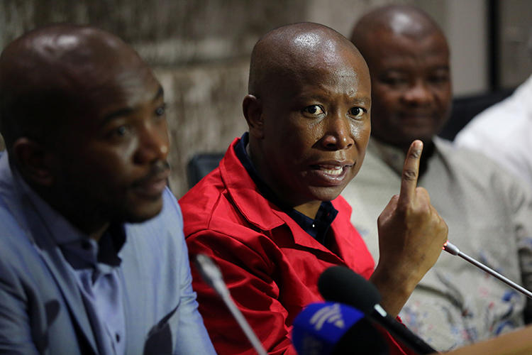 Julius Malema, leader of the opposition Economic Freedom Fighters (EFF) party, speaks during a media briefing at Parliament in Cape Town, South Africa, on February 12, 2018. The Johannesburg High Court ruled on June 6, 2019, that Malema and the EFF violated the Electoral Act by doxxing Karima Brown in March. (Reuters/Sumaya Hisham)