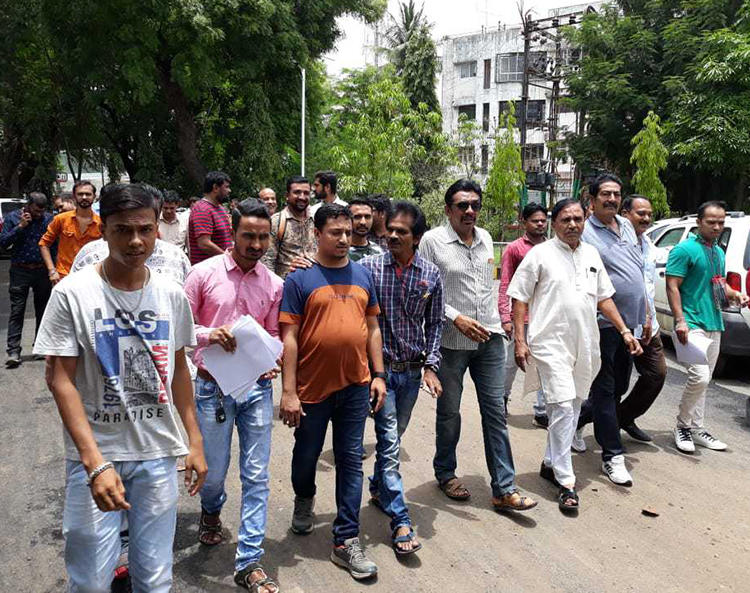Harshad Ahir (second from left) and fellow journalists march in Valsad, Gujarat, after the journalist was attached on June 6, 2019. (Image via Harshad Ahir)