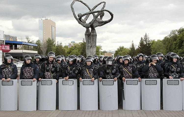 Kazakh police block an area to prevent protests against presidential elections in Nur-Sultan, the capital city of Kazakhstan, on June 10, 2019. Local internet users are being asked to download a security certificate that could allow the authorities to monitor or censor encrypted websites. (AP Photo/Alexei Filippov)