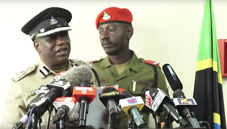 A screenshot of Dar es Salaam police chief Lazaro Mambosasa, left, speaking at a July 30 press conference. Mambosasa said that police have detained freelancer Erick Kabendera. (YouTube/Kwanza TV)