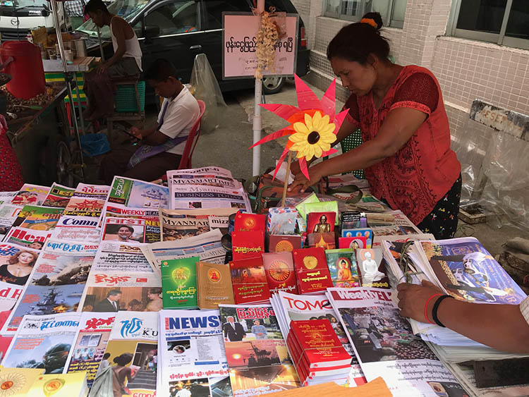 A market stall sells newspapers in Yangon, in June 2019. Journalists in Myanmar say their reporting is still met with legal action and censorship. (CPJ/Shawn Crispin)
