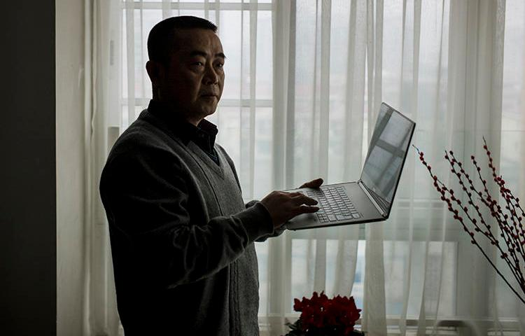 Chinese journalist Huang Qi is seen in Chengdu, Sichuan province, on January 22, 2015. Today, Huang was sentenced to 12 years in prison. (AFP/Fred Dufour)