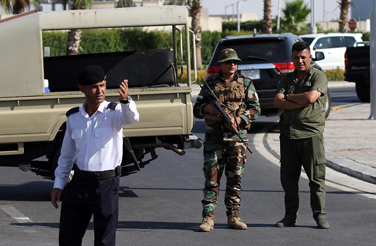 Iraqi Kurdish security officers are seen in Erbil on July 17, 2019. That day, officers from the Kurdish Counter-Terrorism Forces assaulted Al-Jazeera reporter Ahmed al-Zawiti. (AFP/Safin Hamed)