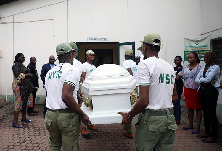 Members of National Youth Service Corp carry the body of their colleague, the reporter Precious Owolabi, in Abuja on July 23. Owolabi was shot while covering protests in the Nigeria capital. (AFP/Kola Sulaimon)