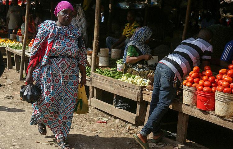 A local market in Dar es Salaam, pictured in May 31. A group of armed men forcefully took an investigative journalist from his home outside the city on July 29. (AFP/Said Khalfan)