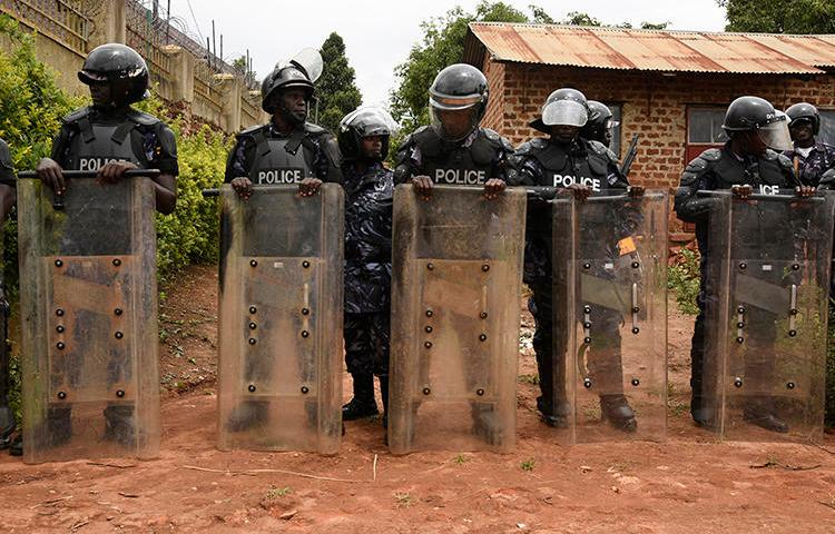 Ugandan police officers are seen in Kampala on April 23, 2019. Police recently arrested Joseph Kabuleta for allegedly posting