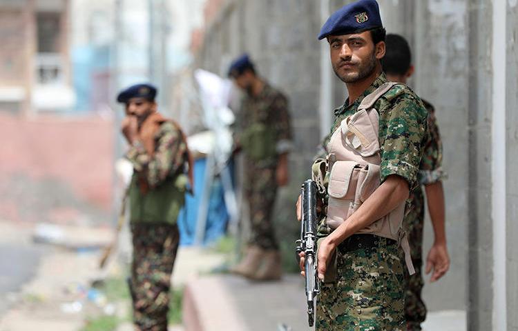 Yemeni police officers are seen in Taez on July 2, 2018. Yemeni security forces recently arrested freelance journalist Yahya al-Sawari. (AFP/Ahmad al-Basha)