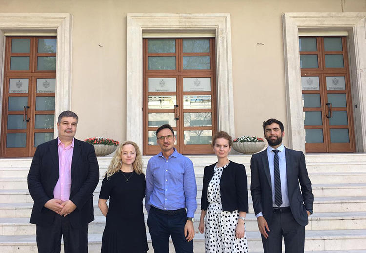 Members of the press freedom mission to Albania, pictured outside the prime minister's office in Tirana, in June. From left, Oliver Vujovic from SEEMO, Sarah Clarke, of Article 19, CPJ Europe Correspondent Attila Mong, Flutura Kusari of ECPMF, and Scott Griffen of IPI. (Flutura Kusari)
