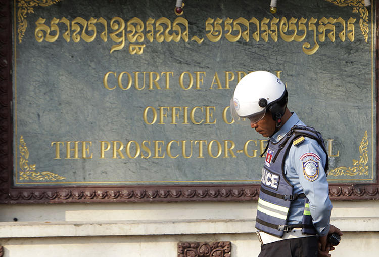 A police officer is seen in Phnom Penh, Cambodia, on February 1, 2018. Two Cambodian journalists were recently arrested and face incitement charges for live-streaming a protest. (AP/Heng Sinith)