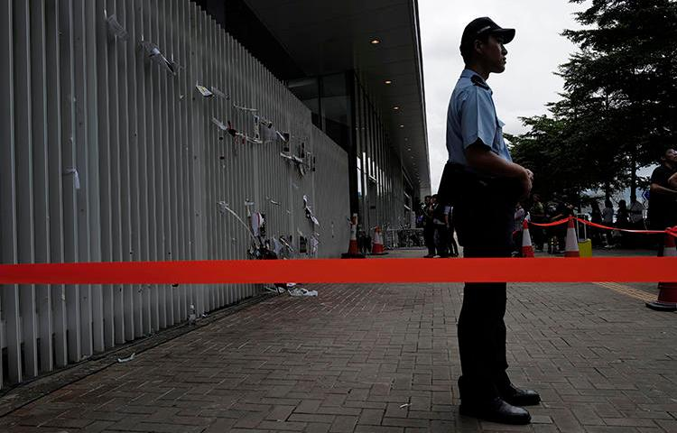 A police officer is seen in Hong Kong on July 2, 2019. On July 1, unidentified assailants vandalized pro-democracy broadcaster Citizens' Radio. (AP/Vincent Yu)