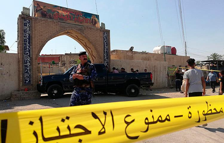 Security forces are seen in Baghdad, Iraq, on June 21, 2019. The Baghdad offices of Al-Journal and 7C TV were recently raided in Baghdad following a corruption investigation. (AP/Hadi Mizban)