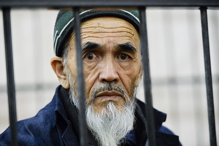 Journalist Azimjon Askarov is seen in a courtroom in Bishkek, Kyrgyzstan, on October 11, 2016. A court today upheld his life sentence in prison. (AP/Vladimir Voronin, file)