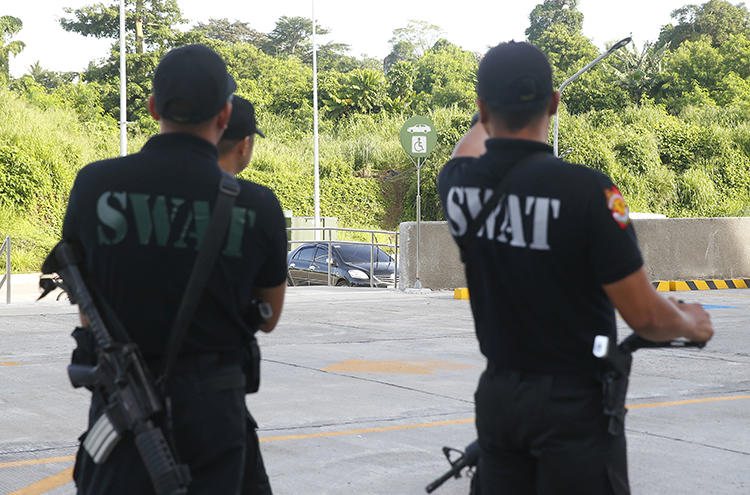 Philippine National Police SWAT members are seen in Tanauan City on July 4, 2018. Radio broadcaster Eduardo Dizon was recently killed in Kidapawan City, in the southern Philippines. (AP/Bullit Marquez)