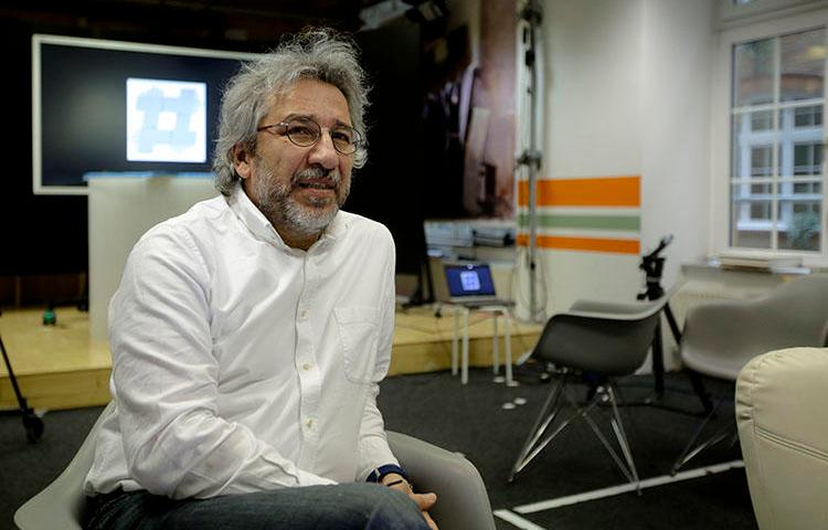 Can Dündar, the former editor-in-chief of Cumhuriyet newspaper pictured on April 7, 2017, now runs nonprofit online radio station 'Ozguruz' from exile in Germany. (AP/Markus Schreiber)