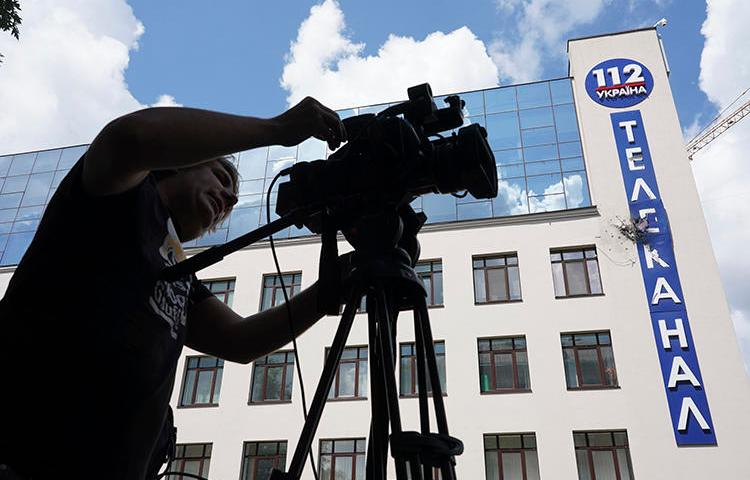 The damaged building of Ukrainian broadcaster 112 Ukraine is seen in Kiev on July 13, 2019. The broadcaster, along with NewsOne, have faced threats and attacks in the run-up to Ukraine's parliamentary elections. (AP/Evgeniy Maloletka)