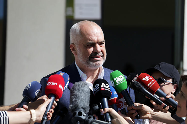 Albania's Prime Minister Edi Rama speaks to the media outside a polling station near Tirana on June 30. A press freedom mission raised several issues with Rama last month, including unresolved attacks on journalists and draconian laws. (Reuters/Florion Goga)