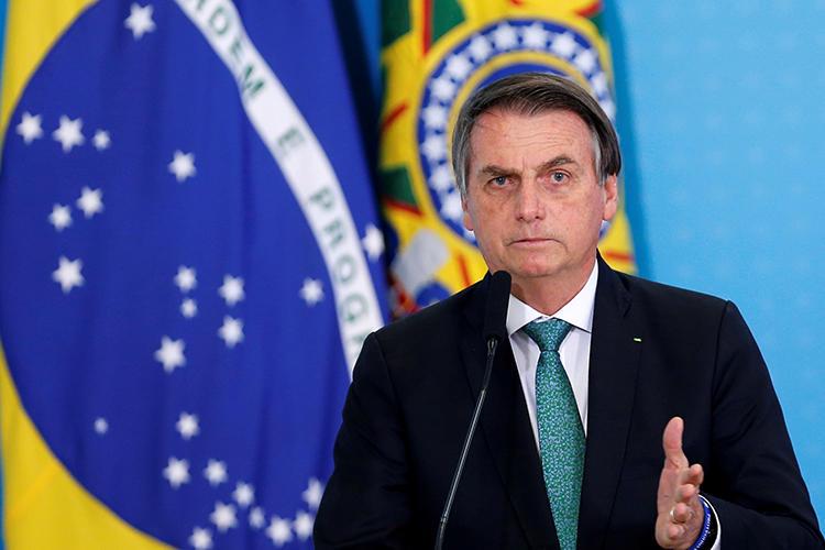 Brazilian President Jair Bolsonaro is seen in Brasilia on July 24, 2019. He recently threatened that journalist Glenn Greenwald may face jail time in Brazil. (Reuters/Adriano Machado)