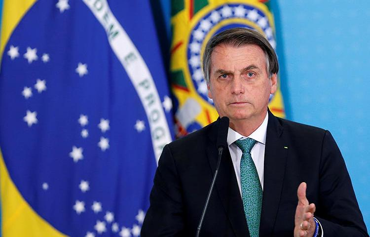 Brazilian President Jair Bolsonaro is seen in Brasilia on July 24, 2019. He recently threatened that journalist Glenn Greenwald may face jail time in Brazil. (Reuters/Adriano Machado)