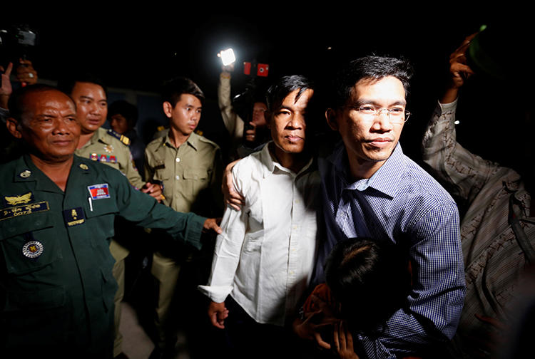 Uon Chhin and Yeang Sothearin, former journalists for Radio Free Asia, are seen in Phnom Penh, Cambodia, on August 21, 2018. The journalists are being tried on espionage charges. (Reuters/Samrang Pring)