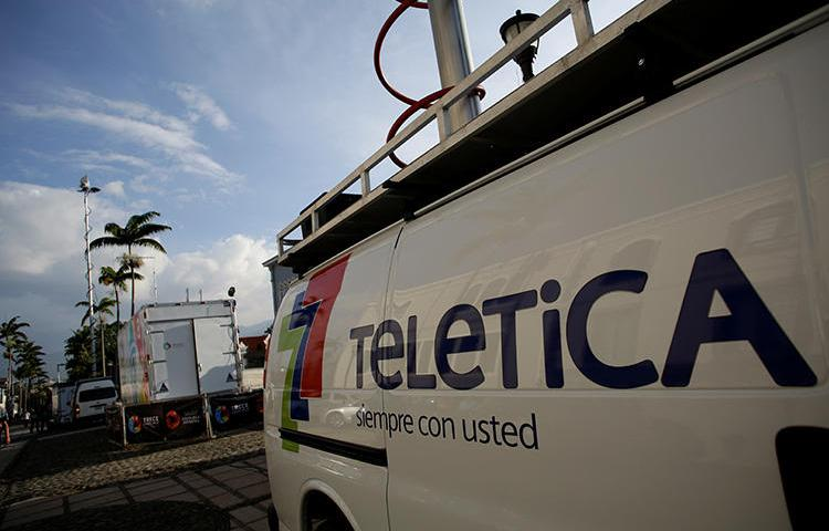 A mobile television unit from Teletica broadcasts the last state of the nation address by Costa Rica's President Luis Guillermo Solis at the Congress in San Jose, Costa Rica, on May 2, 2018. An explosive was detonated outside Teletica's office in San Jose on July 27, 2019. (Reuters/Juan Carlos Ulate)