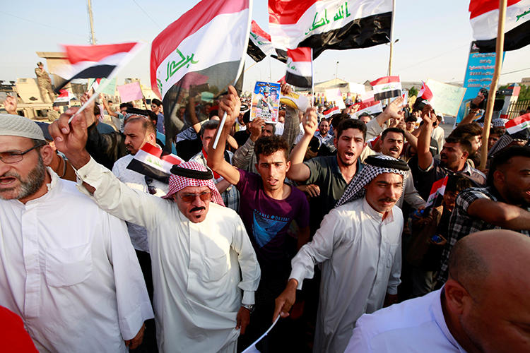 Demonstrators are seen in Basra, Iraq, on July 19, 2019. During the protest, demonstrators assaulted journalist Ayman al-Sheikh. (Reuters/Alaa Al-Marjani)