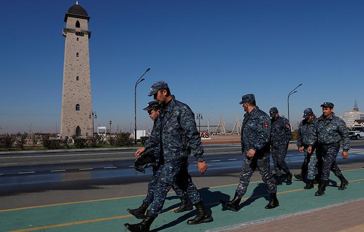 Police officers are seen in Magas, Ingushetia, on October 8, 2018. FSB agents in Ingushetia recently detained and allegedly tortured journalist Rashid Maysigov. (Reuters/Maxim Shemetov)