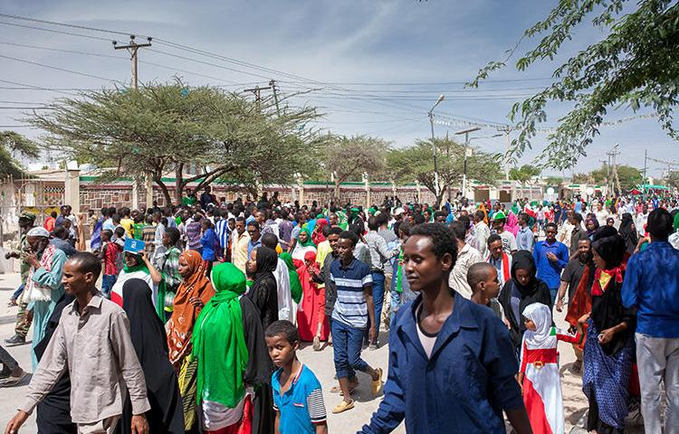People take part in celebrations of the 27th anniversary of self-declared independence of Somaliland in Hargeisa, on May 15, 2018. Somaliland police on July 30, 2019, arrested four Eryal TV journalists filming a corruption story in Hargeisa. (Mustafa Saeed/AFP)
