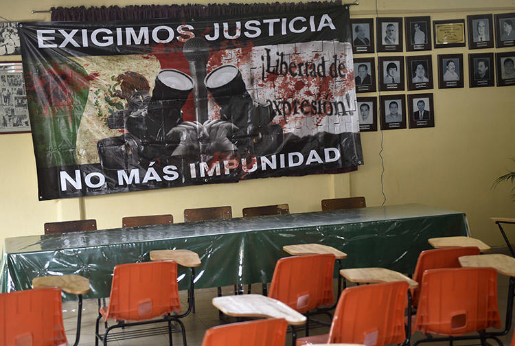 A sign reading 'We demand justice. No more impunity' hangs at the journalists' union office in Chilpancingo, Guerrero state, in May 2017. Two journalists from the state were killed within days of each other this week. (AFP/Pedro Pardo)