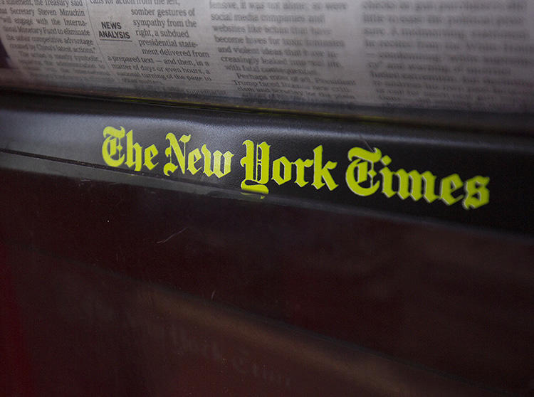 The New York Times logo is seen on a newspaper rack at a convenience store in Washington, D.C., on August 6, 2019. CPJ and RCFP filed a lawsuit on August 8 seeking documents in a leak investigation involving a Times reporter. (AFP/Alastair Pike)