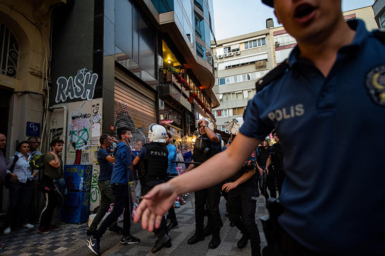 Police detain a protester in Istanbul on August 20, 2019. At least seven journalists were recently arrested throughout Turkey. (AFP/Yasin Akgul)