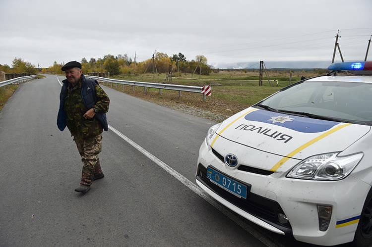 A police car is seen in Chernihiv, Ukraine, on October 9, 2018. Blogger Igor Stakh was recently assaulted in Chernihiv. (AFP/Genya Savilov)
