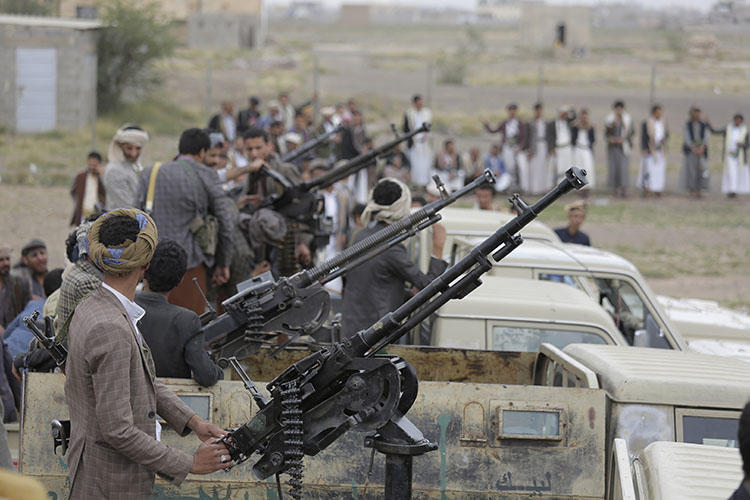 Houthi fighters ride on trucks mounted with weapons during a gathering aimed at mobilizing more fighters for the rebel movement in Sanaa, Yemen, on August 1, 2019. (AP/Hani Mohammed)