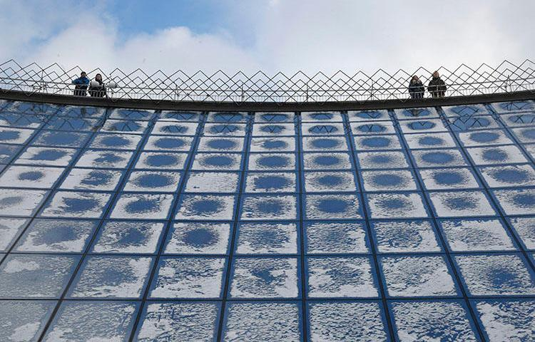 People look across at the city central square from the mall viewing platform covered with snow in Kiev, in January 2019. A court in the city on August 6 ruled against Hromadske TV in a case over the outlet's tweet about a nationalist group. (AP/Efrem Lukatsky)
