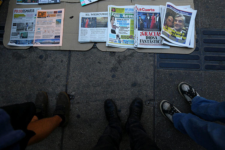 Newspapers are sold on a sidewalk in Santiago in March 2018. Chile's army allegedly ordered a surveillance operation against the investigative journalist Mauricio Weibel Barahona in 2016. (Reuters/Ivan Alvarado)