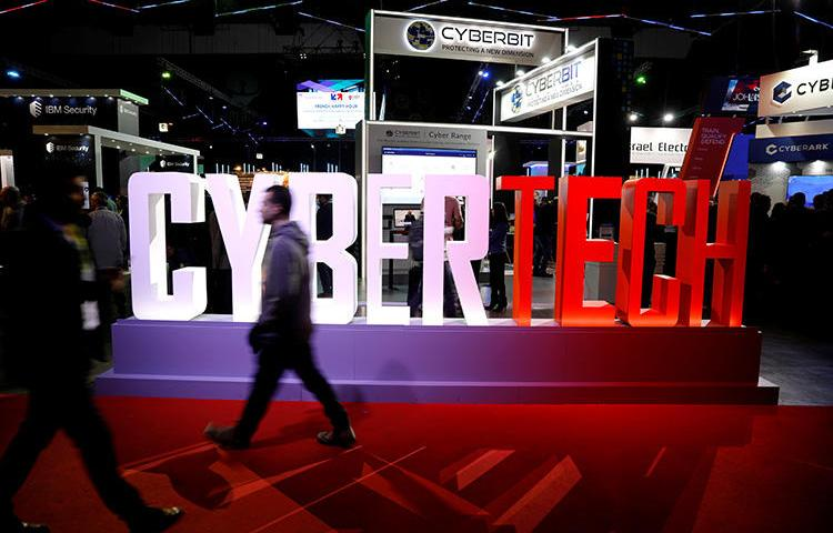 A visitor walks past company exhibition stands at the Cybertech 2019 conference in Tel Aviv, Israel, on January 29, 2019. Reuters reported on August 22, 2019, that Israel has eased export controls on surveillance technologies. (Reuters/Amir Cohen)