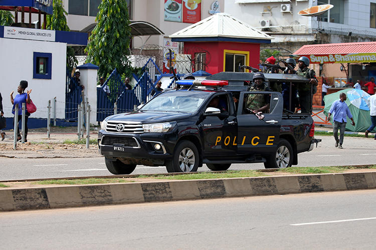 Police are seen in Abuja, Nigeria, on July 23, 2019. Nigerian publisher Agba Jalingo has been detained since August 22 without charge. (Reuters/Afolabi Sotunde)