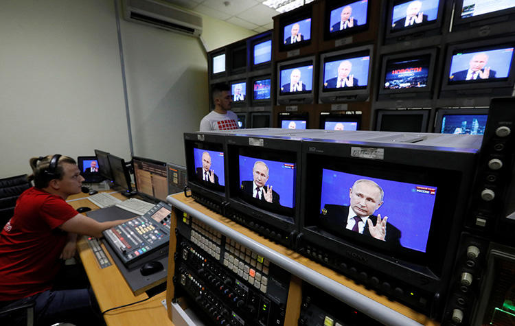 "Employees of a regional TV company work during the broadcast of an annual nationwide televised phone-in show attended by Russian President Vladimir Putin in Krasnoyarsk, Russia June 20, 2019. Journalist Mikhail Romanov found guilty of ""abuse of freedom of information"" and ""false"" news in the city of Yakutsk on July 25. (Reuters/Ilya Naymushin)"