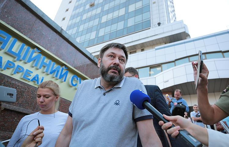 Kirill Vyshinsky, director of the Ukrainian office of the Russian state news agency RIA Novosti, talks to the media after a court ordered his release on bail, in Kyiv, Ukraine August 28, 2019. (Reuters/Serhii Nuzhnenko)