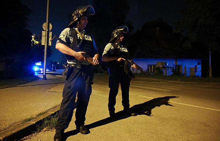 Police officers are seen in Zagreb, Croatia, on August 1, 2019. Police recently arrested journalist Gordan Duhaček in Zagreb. (AFP/Denis Lovrovic)