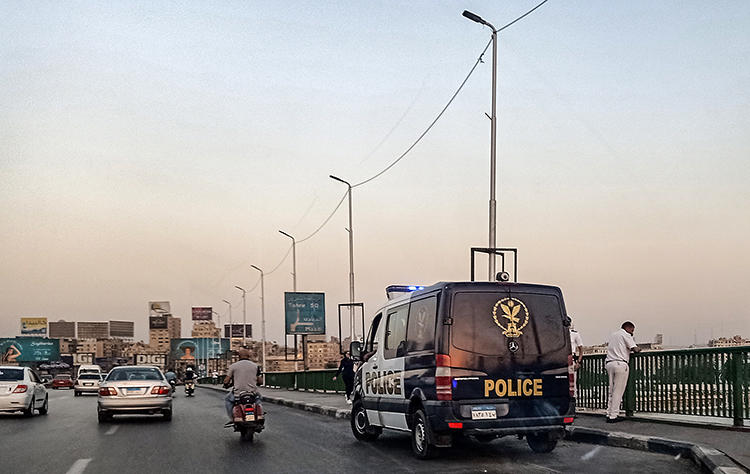 Police officers are seen in Cairo, Egypt, on September 21, 2019. Police recently arrested several journalists covering protests in Cairo and other cities, and authorities blocked news websites and Facebook Messenger. (AFP/Mohamed el-Shahed)