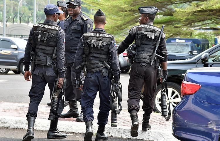 Police forces are seen in Malabo, Equatorial Guinea, on February 3, 2015. Police in Bata recently arrested two journalists and held them for 13 days without charge. (AFP/Issouf Sanogo)