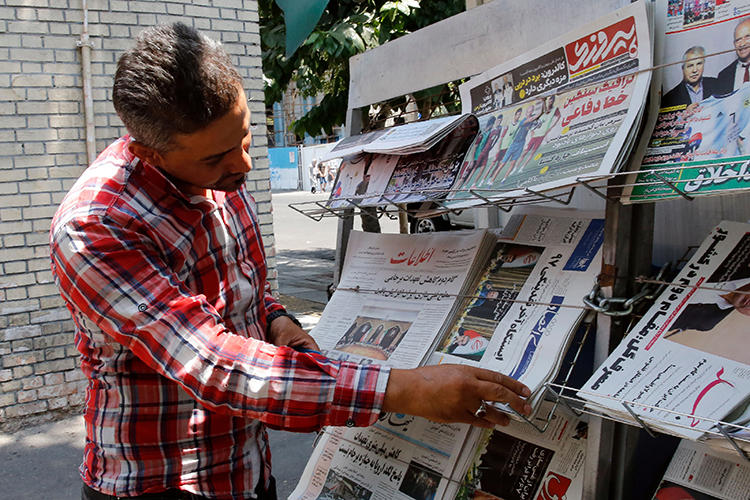 A newspaper stand is seen in Tehran, Iran, on July 8, 2019. Newspaper columnist Hossein Ghadyani was recently sentenced to six months in prison for an Instagram post. (AFP)