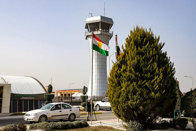 A journalist films outside the Sulaymaniyah International Airport in January 2019. Journalists in Iraqi Kurdistan say disputes between the region's main political parties, the PDK and PUK, leave the press vulnerable. (AFP/Shwan Mohammed)