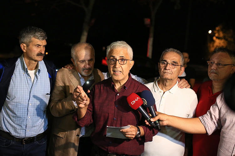 Former staffers of the Turkish daily newspaper Cumhuriyet--cartoonist Musa Kart (C), columnist Guray Oz (L), board member Onder Celik (L2), layers Mustafa Kemal Gungor (R2), and columnist Hakan Kara (R)--speak with journalists after their release near from Kandira prison, in Kandira, Turkey, on September 12, 2019. A joint mission to Turkey found that the press freedom situation remains highly restrictive, despite some room for very cautious optimism. (Stringer/Cumhuriyet Daily Newspaper/AFP)