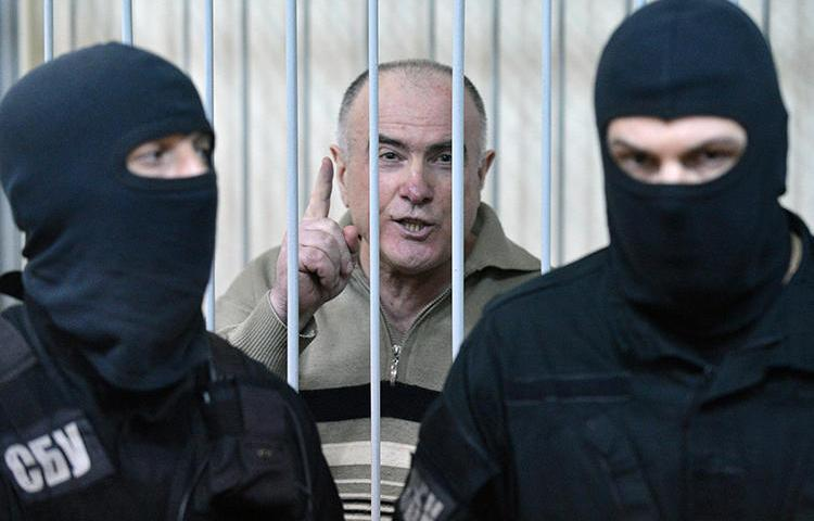 Aleksei Pukach is seen at a Kiev district court on January 29, 2013. Pukach was convicted in the 2000 murder of journalist Georgy Gongadze, and is now appealing his life sentence. (AFP/Sergei Supinsky)