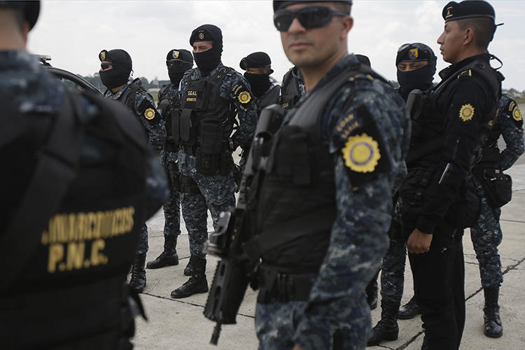 Police officers are seen in Guatemala City on May 20, 2019. Police in El Estor recently raided the Mayan Xyaab' Tzuultaq'a radio station. (AP/Moises Castillo)
