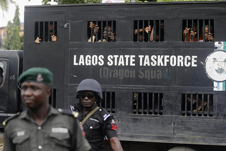 Police officers are seen in Lagos, Nigeria, on August 5, 2019. Lagos police recently arrested publisher Agba Jalingo, who has been charged by federal authorities with treason. (AP/Sunday Alamba)